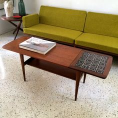 I like this old/70's - looking table. Danish Mid Century Modern Atomic Tile Top by TheModernHistoric, $1200.00