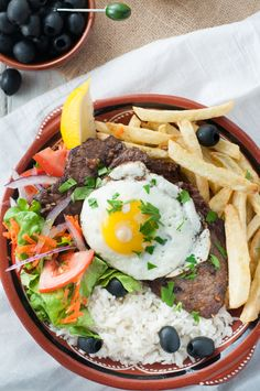 Portuguese house steak - Bitoque. This steak and egg recipe is one of the most recognized Portuguese dishes and it's served at many Portuguese restaurants in and outside of Portugal.