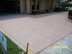 Before: a boring driveway that had no real character at all. Concrete Dye, Stained Concrete, Concrete Coatings, Before And After Pictures, Restoration, Sidewalk, Patio, Outdoor Decor, Character