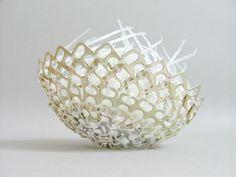 Clever bowl made of zip ties and soda bottle pop top tabs