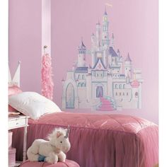 Large wall mural of princess castle in pink and purple with glitter accents. Princess castle giant wall stickers for princess-themed girls rooms. Pairs perfectly with large Disney Princess wall murals, especially Cinderella large wall decals