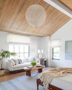 How incredible is this bedroom sitting area by @coatshomes? Mill Ceiling Light and Culloden Table Lamp by AERIN. #coatshomes #aerinlighting #circalighting