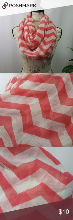 5/$25 Infinity Scarf Coral chevron print scarf. New with tags. There is a snag across the width of the scarf shown in picture above. Doesn't show when wearing.   Included in the 5 for $25 sale. Bundle with items showing 5/$25, offer $25 and I will accept. Accessories Scarves & Wraps