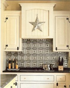 A very inexpensive and cool idea.  Plastic tiles that look like a tin ceiling found at Homedepot.  Use adhesive to apply to the wall.  Add texture and design to the kitchen. I'd love to do this to the entire kitchen wall between the cabinets and countertop! It adds pop. I bet you could do this in an apartment with command strips.