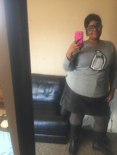 BBW look. Grey shimmer sweater, black leather skirt, grey tights, and black knee high boots. Whimsical weekend outfit pair with an orange lip