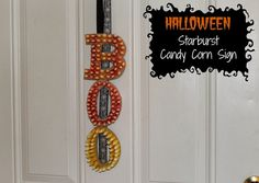 """Make this DIY hanging """"BOO"""" sign with Starburst Candy Corn. Great way to use up any of this year's leftover candy and have a new decoration for next year (sponsored) #StarburstCandyCorn"""
