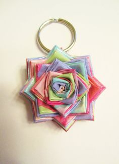 Duck / Duct tape flower key chain made out of cotton candy duct tape :) Perfect to put anywhere :) Pretty