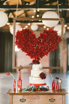 diy heart backdrop and vintage cake table vignette #caketable #diy #weddingchicks http://www.weddingchicks.com/2014/02/13/spicy-love-wedding-inspiration/