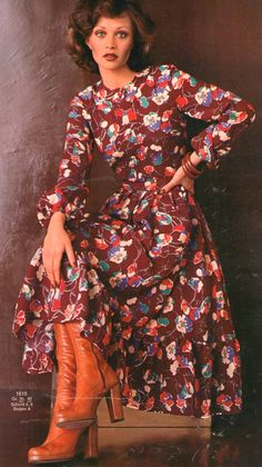 1975 Fashion 70s day dress full skirt graphic floral print red burgundy ruffle hem leather boots secretary model magazine casual office vintage fashion style
