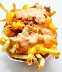 Fries with cheese sauce and caramelized onions. Just like in Pittsburgh!