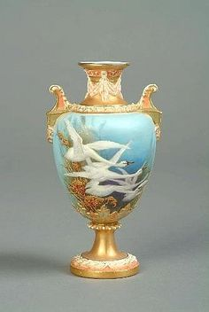 A ROYAL WORCESTER PORCELAIN PEDESTAL VASE ovoid, the body painted with swans in flight with rushes and gilded foliage, the obverse with swallows against a sky blue ground, by Charles Baldwyn, the neck, handles and pedestal foot gilt and moulded with drapery and leafage, model no. 1482, date code for circa 1898, 6 1/4in. (16cm) high, ( restored socle) (see illustration)