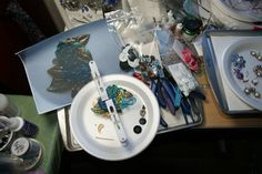 This is my Work Table Wednesday 09.23.15. This is my first assemblage piece I dreamed up (notice photo of placement). I am using plastic clothespins from the dollar store to hold the pieces on top of the buttons used to support the piece due to B'Sue videos on how to do this. All pieces from B'Sue Boutiques.