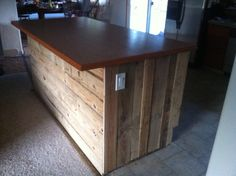 Line a kitchen island with old pallet wood. Stagger sizes. Ropes wit cabinet grade plywood.