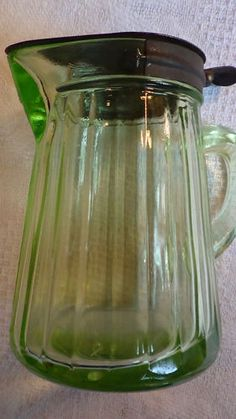 Green Depression Glass Syrup Pitcher with Tin Plated Steel Cover