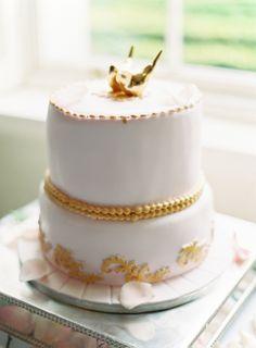 pink and gold cake http://www.weddingchicks.com/2013/12/03/classic-dublin-wedding/