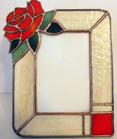 """""""The Tropicana Rose"""" is a lovely stained glass picture frame created by award winning International artist, Carl Correll of Avalon Stained G Stained Glass Frames, Stained Glass Ornaments, Stained Glass Flowers, Stained Glass Designs, Stained Glass Projects, Stained Glass Patterns, Stained Glass Art, Stained Glass Windows, Glass Picture Frames"""