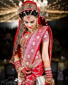 bride in a lovely katan saree.
