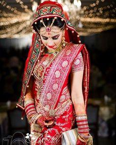 bride in a lovely katan saree.