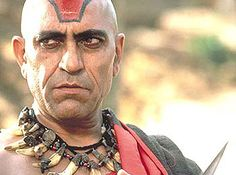 """Steven Spielberg tried his hand at making a movie about Thuggees with """"Indiana Jones and the Temple of Doom"""": frequently condemned for its racism and violence. Pictured: the chief Thuggee. Top Villains, Amrish Puri, Indiana Jones Films, Making A Movie, Steven Spielberg, Bollywood Actors, Hinduism, In Hollywood, Indie"""