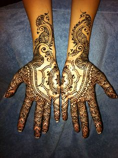 "Lovely bridal mehndi. This design is intricate, but also very open and ""clean"" looking."