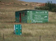I love this picture on so many levels. Rural South Africa and this person used geographical motorist signs to construct the walls of his home. It reminds me of a South African saying 'Oos, wes, tuis bes' (East, west, home best) Funny Road Signs, South Afrika, Out Of Africa, Thing 1, My Land, Home Signs, Pretoria, Cape Town, Funny Pictures