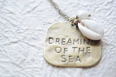 Dreaming of the Sea-- Antiqued brass necklace with shell and pearl. $18.50, via Etsy.