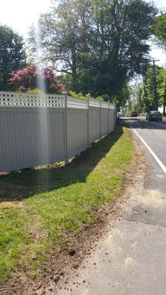 MG's Lawn Green installed this beautiful white, lattice topped privacy fence for another happy homeowner in Pleasantville, New York. Fence With Lattice Top, Residential Landscaping, Building A Fence, Westchester County, White Fence, Green Lawn, Sidewalk, Country Roads, Yard