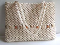 Wow!! Is this HUGE or what!! I wanted to make a big purse but didn't think it would make up this large. There are 1520 macrame knots in this purse. I counted them.