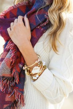 Printed scarf, white sweater, stacked bracelets