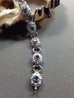 .925 Sterling Silver Bracelet with 10 4mm Round Blue Topaz
