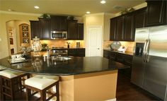 Kitchen, cabinets may be a bit dark for a kitchen with no windows.  I like the island though.