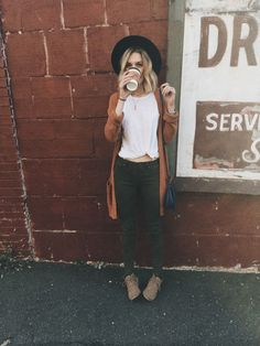 Long sweater and a white tee And coffee