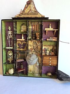 Rare Oddities Apothecary Cabinet. Perfect for Halloween home decor, or for any lover of skeletons, books, owls and odds and ends. @Graphic45; Apr 2015