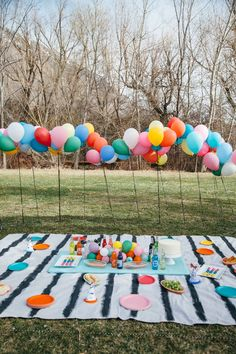 Creating a balloon fence is a festive way to close off an area in a public space to make it feel like a private party.