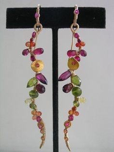 by bellajewelsII  - earrings. stunning & fun. 14K, hot pink sapphire, yellow..orange...orange/red and red sapphires, magenta pink rhodolite garnet, hot pink quartz, red garnet, vesuvianite and peridot.