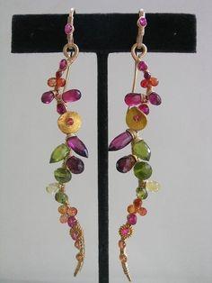 by bellajewelsII  - earrings. stunning & fun. 14K, hot pink sapphire, yellow..orange...orange/red and red sapphires, magenta pink rhodolite garnet, hot pink quartz, red garnet, vesuvianite and peridot.