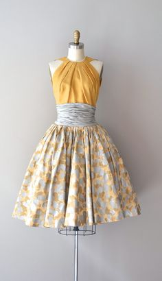 Estévez silk dress with mustard silk halter bodice, 1950s. Image © Dear Golden (Etsy)