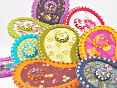 """One of a kind 100% wool felt brooch with paisley shape, embriodery beads and coordinate cotton fabric. Safety pin in the back. Aproximate measurements:3 1/2 """"(9cm) high and 2"""" (5cm) wide. Totally handmade item. Customer can choose the favourite color and is possible to make custom orders if desired. Great shop with very good feedback, don´t let to take a look at the rest of items avaliable."""