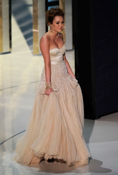 Miley Cyrus cream tulle gown with sparkle detail (2010 Academy Awards)