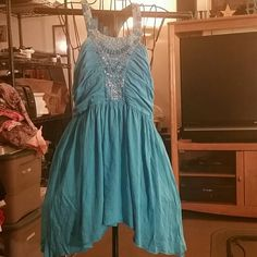 XXI Beaded flowy top. Never worn.  Gorgeous! Never worn.  Lots of beads on the front and back. None missing.  No holes or stains.  Dress up or down. Has a shark tooth hem.  ??For better prices make a bundle and get 15% off!??  ??I do not trade?? XXI Tops Tank Tops