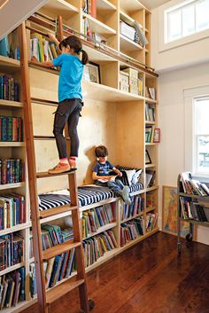 """A former   closet was transformed into a double-height library, complete with a reading nook and a rolling ladder from Spiral   Stairs of America. """"That's my   favorite part of the house,"""" says Dan.   """"When I see Stella reaching for a book,   there's nothing better."""""""