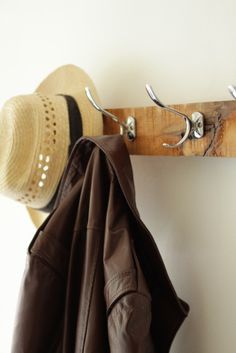 A simple coat rack made from a salvaged hardwood beam, featuring the natural imperfections of the wood. Natural oil finish. #coatrack #diy