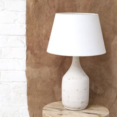 Newport Ceramic Lamp - Stone || With lighting, as with all things in life, you should always start with a good base. This ceramic lamp base is perfect: strong, grounded and ready for you to build upon with one of our natural linen lampshades. White ceramic with beautiful stone effect.