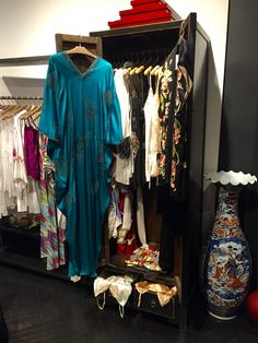 Get ready for pool side season with a colorful Josie Natori caftan.