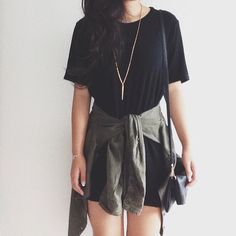 Cute black tee dress with a green military jacket around the waist and long necklace