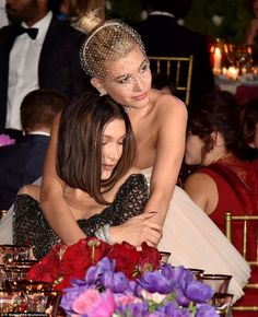 Model behaviour:Bella Hadid and Hailey Baldwin were seen cuddling up at the dinner table...