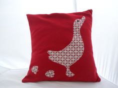 Wool cushion in red with duck applique...
