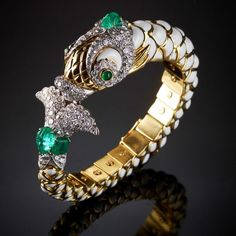 FISH  Carved and cabochon emeralds, brilliant-cut diamonds, white enamel, 18K gold and platinum