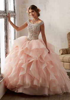 Morilee Quinceanera Dresses  STYLE NUMBER: 89138 Jeweled Beading on a Flounced Organza Ballgown  Beautiful Quinceañera Ballgown featuring a Fully Beaded Bodice with Off-the-Shoulder Neckline and a Breathtaking Flounced Organza Skirt Accented with Horsehair Trim. Matching Bolero Jacket included. Colors available: Deep Aqua/Nude, Blush/Nude, White/Nude.