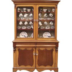 antique country style china cabinet imported from england and dating back to the unique combination of oak and mahogany makes this an elegant antique english country armoire circa 1830s